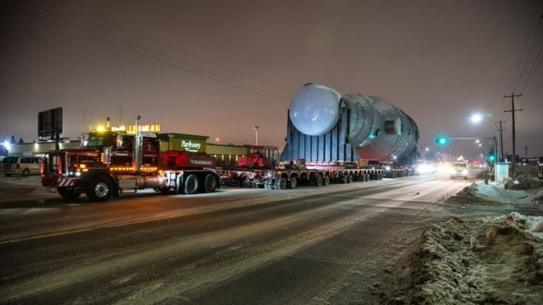 Super-sized load the length of a football field hits the road to oilsands