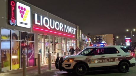 Police parked outside liquor store on Christmas Eve. Portage and