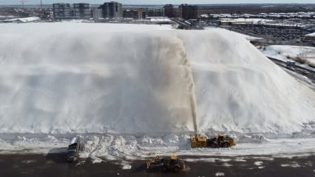 snow removal giant snow pile montreal