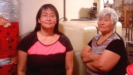 Karen & Rhoda Nanook in front of water tank