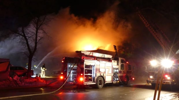 Smoke from St. Boniface auto shop fire sends 6 people to hospital