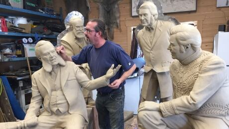"""Artist Nathan Scott with sculpture grouping """"The Unfortunate Four"""""""