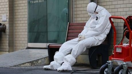 South Korea raises disease alert to highest level as coronavirus cases soar