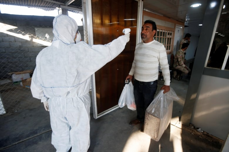 COVID-19 cases surge in Iran, Italy, South Korea, deepening concerns