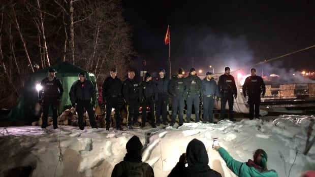 Hereditary chiefs, protesters arrested at rail blockade in northern B.C., say witnesses | CBC News