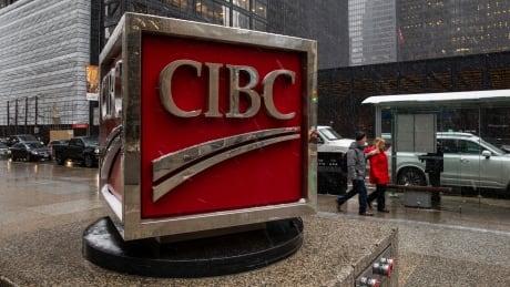 CIBC sign at Bay and King St. in Toronto during a snowfall.