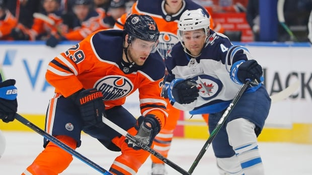 Draisaitl surpasses century point mark to help Oilers down Jets | CBC Sports