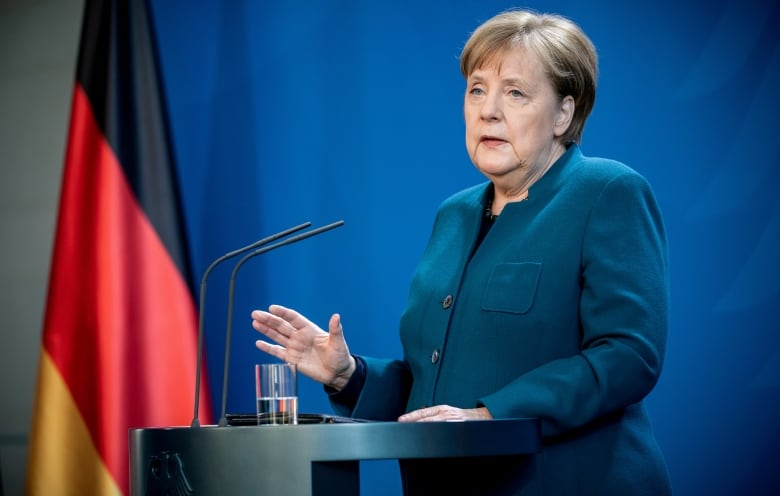 German Chancellor Angela Merkel gives a media statement on the spread of COVID-19 at the Chancellery in Berlin on March 22. She is now in self-isolation after her doctor tested positive for the disease. (Michel Kappeler/Pool/Reuters)