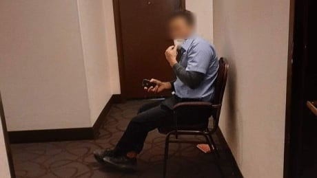 Security guard on watch in Winnipeg hotel with Inuit under isolation
