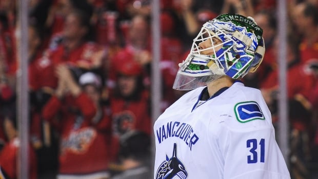 Former Canucks goalie Eddie Lack retires after stepping away with injury