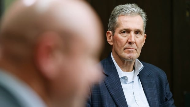 Distancing and a distant premier: The cold arithmetic behind Brian Pallister's early-pandemic fiscal restraint | CBC News