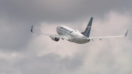 Westjet airplane takes off from Edmonton International Airport