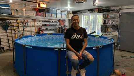 Amélie Kretz sits in front of her homemade endless pool in her parents garage
