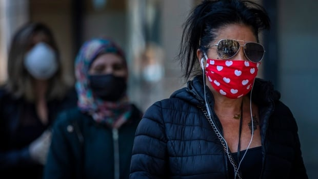The psychology of wearing masks: Why some people are complying and others are not | CBC News
