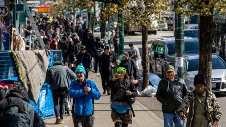Despite the COVID-19 crisis, the streets of Vancouver's Downtown Eastside remain crowded.