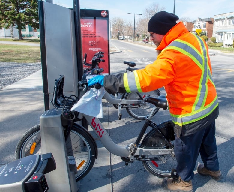What's Happening in Canada. A worker disinfects public bikes in Montreal on Friday.