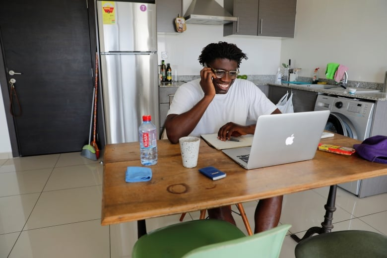 Jeff Provencal, 33, works from home in Accra, Ghana, last month. Companies around the world have had to adjust to co-ordinating and monitoring work from a distance.(Francis Kokoroko/Reuters)