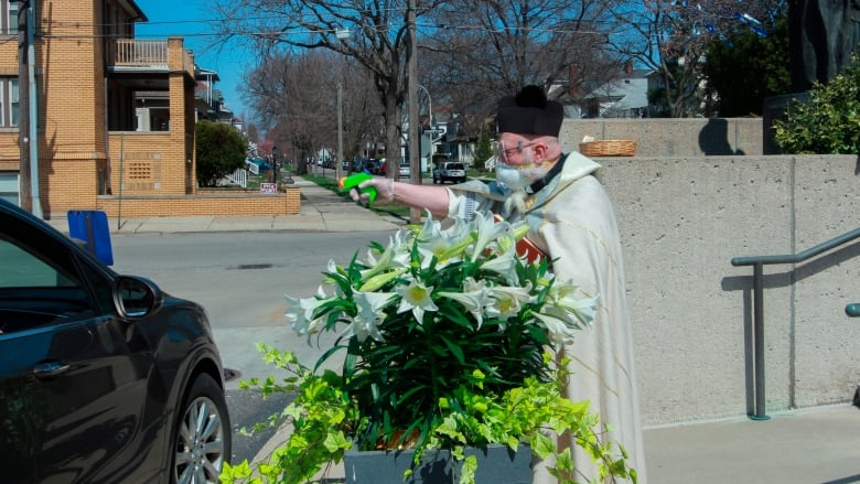 Priest draws squirt gun in fight against coronavirus