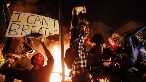 Minneapolis protests rage over George Floyd's death, CNN reporter arrested on air