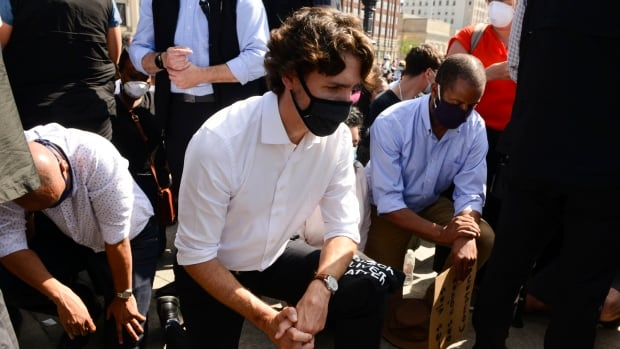 One year after Trudeau took a knee, is his government living up to its anti-racism promises?