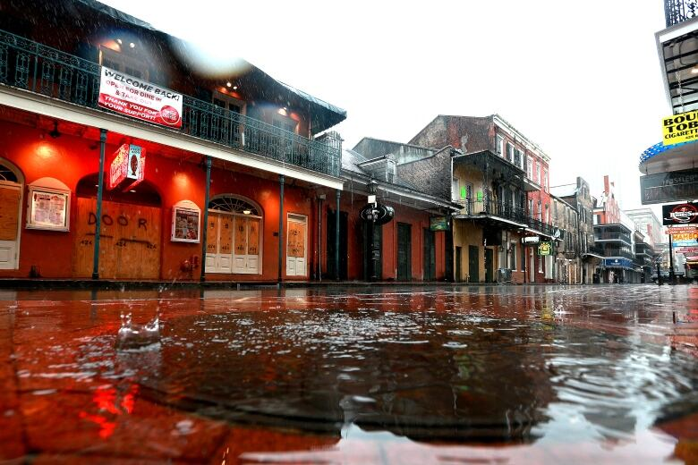Water puddles are seen along Bourbon St. in the French Quarter of New Orleans on Sunday