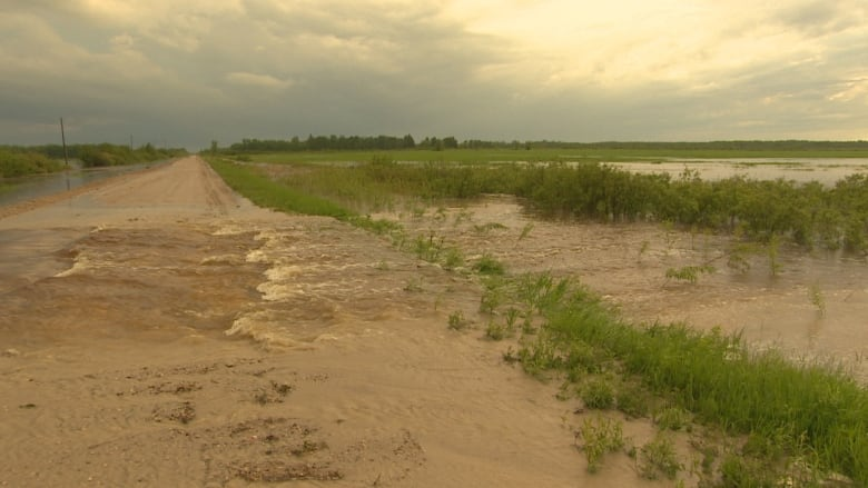 Manitoba community scrambles to prepare for more rain after flooding overwhelms homes