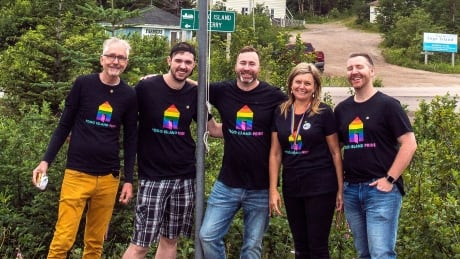 Fogo Island Pride board members raise flag