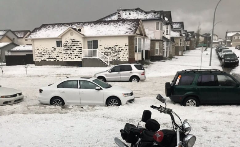 Tornadoes touch down in southern Alberta, as floods and tennis ball-sized hail hit Calgary
