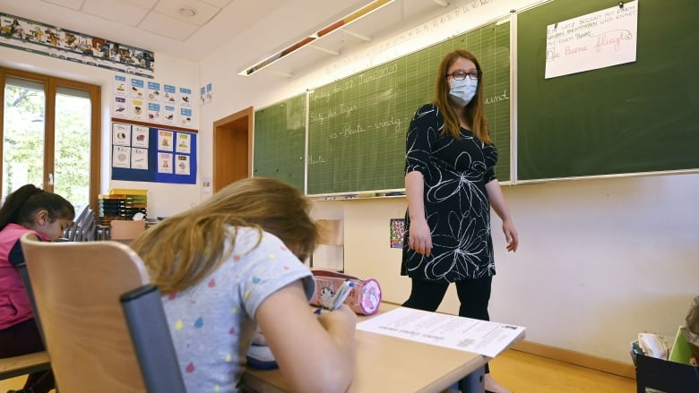 Mandatory masks for staff, some students at school