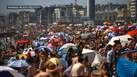 Massive crowds ignoring physical distancing rules flock to U.K. beaches