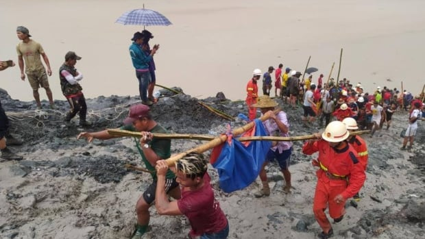 At least 113 killed as Myanmar jade mine collapse buries workers | CBC News