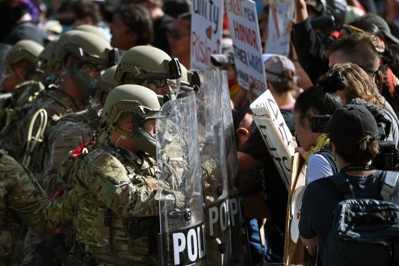 At Rushmore, Trump says protesters seek to 'defame' heroes