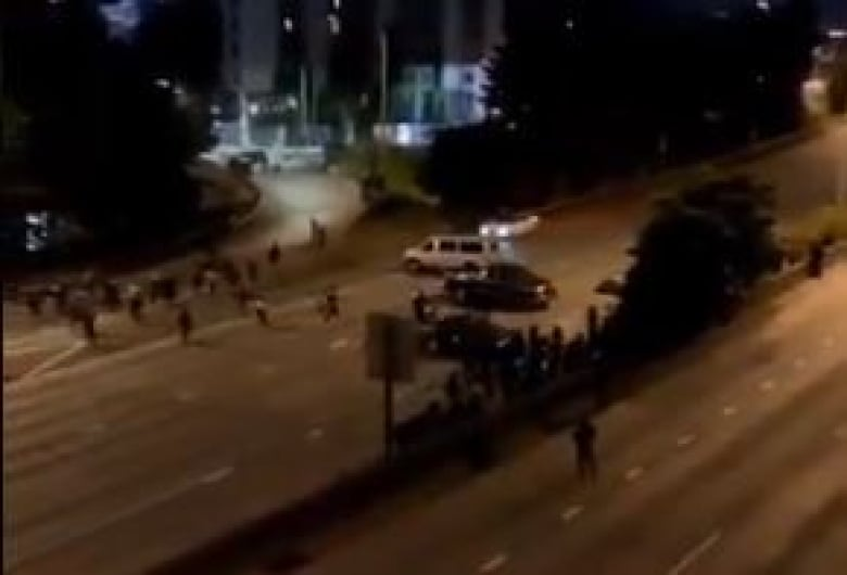 Protester dies after auto  drives through closed highway in Seattle