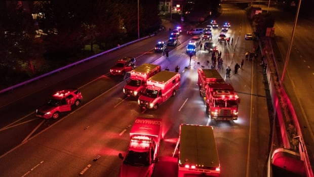 1 of 2 protesters hit by vehicle on Seattle freeway dies; man, 27, charged with vehicular assault | CBC News