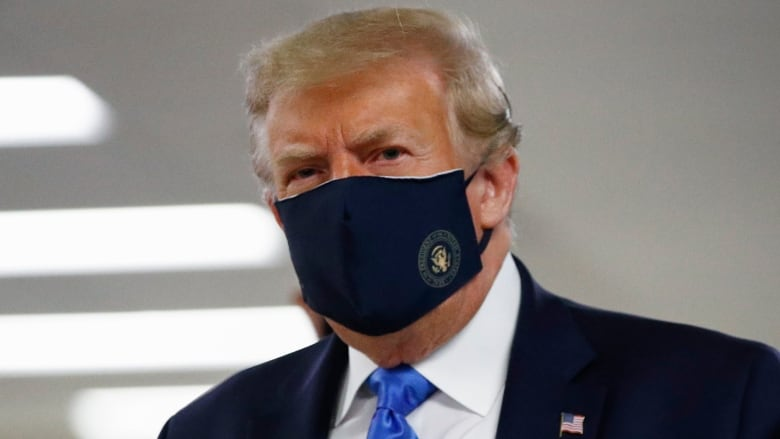 Trump dons face mask for first time