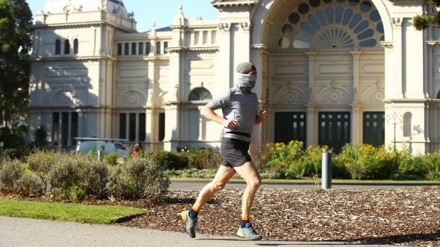 Australia's COVID-19 hot spot marks new daily case record | CBC News