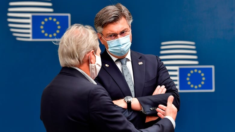 European Union agrees on 'historic' €750bn coronavirus stimulus plan after marathon summit