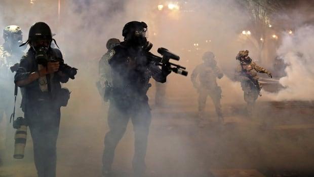 Portland racial injustice protesters breach fence, police declare riot