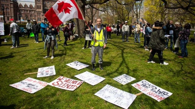 COVID-19 conspiracies creating a 'public health crisis' in Canada, experts say | CBC News