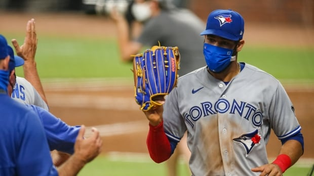 MLB tightening virus protocols, including mandated masks in bullpen and dugout | CBC Sports