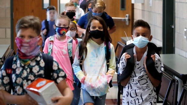 As schools reopen in Canada, how do you test for kids who are asymptomatic?   CBC News