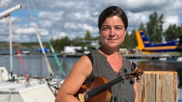 Yellowknife artist hosts float-in concert for launch of new album   CBC News