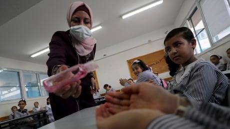 HEALTH-CORONAVIRUS/PALESTINIANS-SCHOOLS