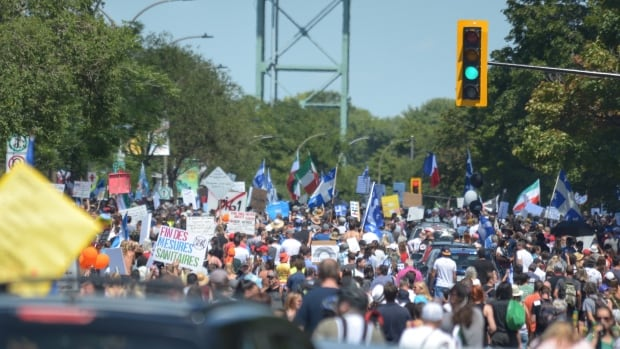 Thousands rally in downtown Montreal to protest Quebec mask rules
