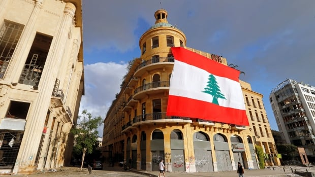 Lebanon information minister resigns as world leaders hold aid conference | CBC News