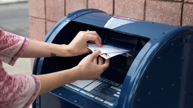 U.S. judge blocks Postal Service changes that slowed mail, calling them 'politically motivated'