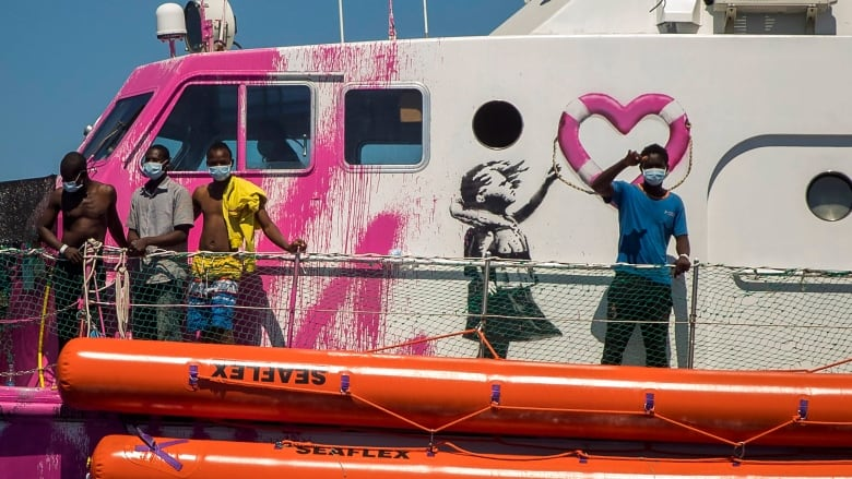 Banksy-funded ship saves migrants in Mediterranean