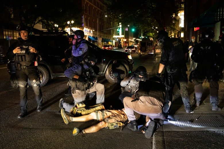 A man is being treated after being shot on Saturday night in Portland, Ore. Fights broke out in the city's downtown as a caravan of supporters of President Donald Trump drove through the city, clashing with counter-protesters. (Paula Bronstein/The Associated Press)