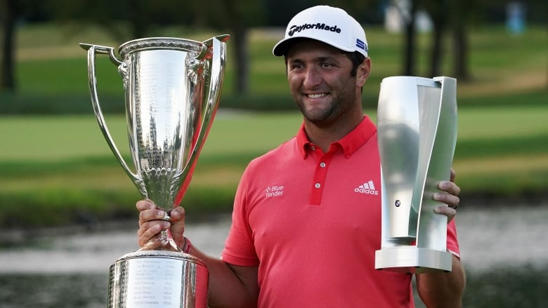 Jon Rahm with BMW trophies