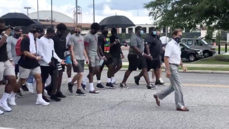 Alabama Football team Marches through campus for Black Lives Matter Protest